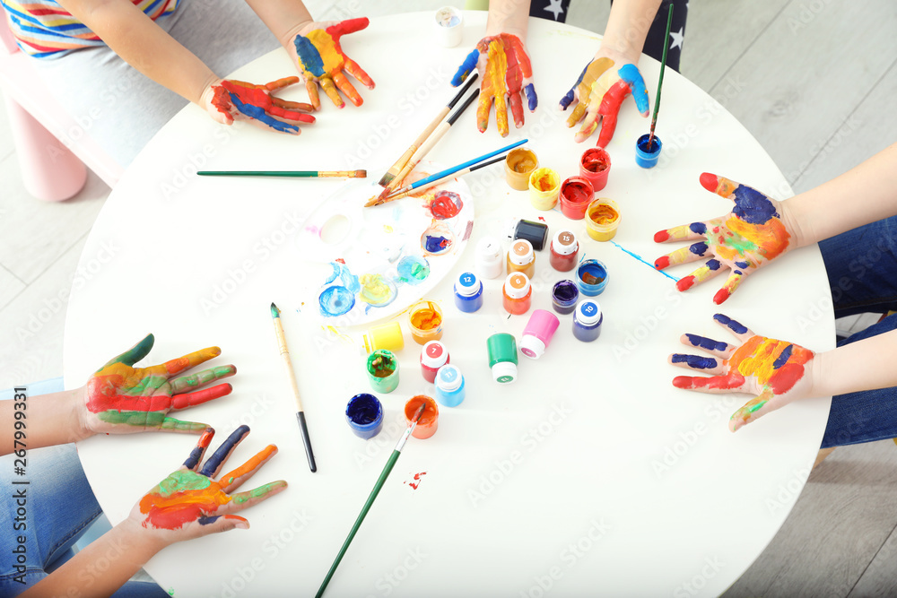 Fototapety, obrazy: Cute little children showing painted hands at lesson indoors, top view