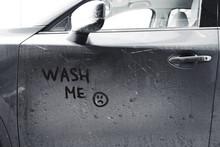 Inscription WASH ME And Sad Sm...