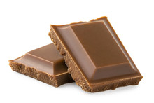Two Squares Of Milk Chocolate Isolated On White. Rough Edges.
