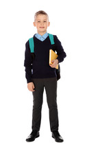Full Length Portrait Of Cute Boy In School Uniform With Book And Backpack On White Background