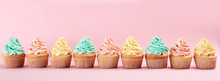 Row Of Delicious Cupcakes On Color Background, Space For Text