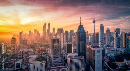 Cityscape of Kuala lumpur city skyline with swimming pool on the roof top of hotel at sunrise in Malaysia Canvas Print
