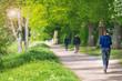 canvas print picture - schöne Frau, Joggerin läuft im Park