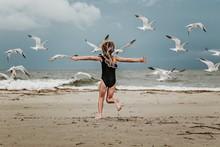 Girl Chasing Birds