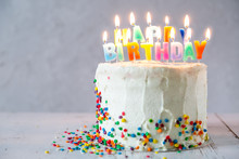 Colorful Birthday Concept - Cake, Candles, Presents, Decorations