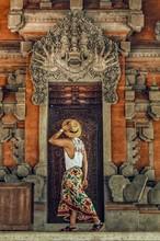 Person Standing Near Temple Door