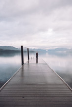 Person Standing On Wooden Lake...