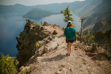 Woman Hiking On A Hill