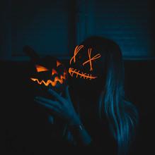 Woman Holding Jack-o'-lantern