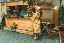 Woman Next To Fruit Stand