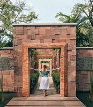 Woman Touching Gate
