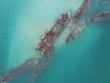 Wrecked Ship On Sea During Daytime