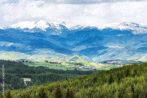 Snowy hills of Rila mountain in Bulgaria during spring, Photo from Rhodope #268033595
