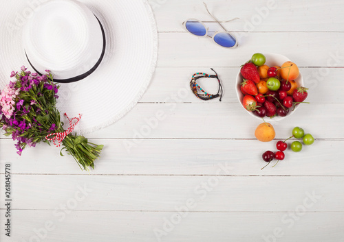 bouquet of flowers with fruits over white wooden table