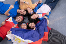 Filipino Group Of People Holding Philippines Flag Celebrating Independence Day
