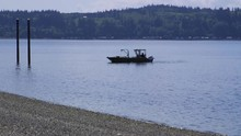 Small, Nondescript Fishing Floating Near Dock At Camano Island State Park, WA State 15sec/24fps Slow Motion. Version 9