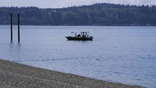Small, Nondescript Fishing Floating Near Dock At Camano Island State Park, WA State. 15sec/24fps Slow Motion. Version 4