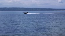 Small, Nondescript Fishing Boat Cruising Past Beach At Camano Island State Park, WA State. Panning. 10sec/60fps