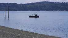 Small, Nondescript Fishing Floating Near Dock At Camano Island State Park, WA State. 55sec/24fps Slow Motion. Version 6