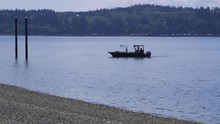 Small, Nondescript Fishing Floating Near Dock At Camano Island State Park, WA State 20sec/24fps Slow Motion. Version 8