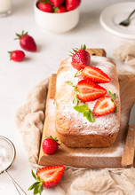 Pound Or Loaf Cake With Strawberry And Mint On Wooden Board. Delicious Summer Dessert.