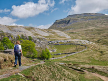 A Single Walker On A Path By Crina Bottom, Heading For Ingleborough, In The Background, In The Yorkshire Dales, UK
