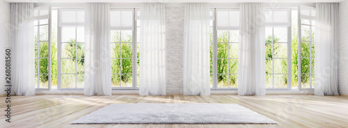 Fototapeta White interior design with large windows obraz