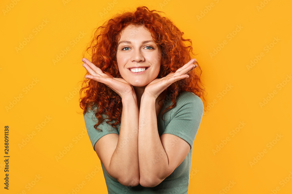 Fototapety, obrazy: Happy redhead woman on color background