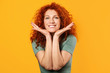 Happy redhead woman on color background