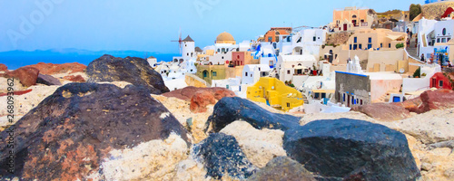 Montage in der Fensternische Santorini Santorini island, Greece, Oia village panoramic banner with windmill and colorful houses view from old stone castle