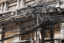 Tangled Messy Wiring On The Streets Of Asia