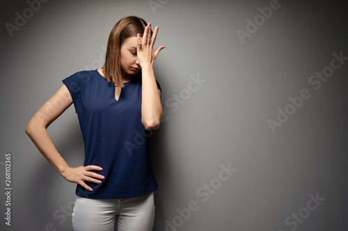 Fotografie, Tablou Facepalm! Disapoppointed and upset young woman against grey wall.