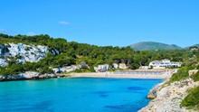 Panoramic Landscape Of The Beautiful Bay Of Cala Estany D'en Mas With A Wonderful Turquoise Sea And The Beach, Near Porto Cristo, Mallorca/Majorca, Spain