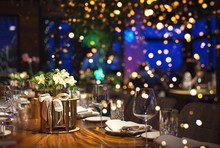 Blurred Background Of People Sitting At Restaurant, Bar Or Night Club With Colorful Lights Bokeh.