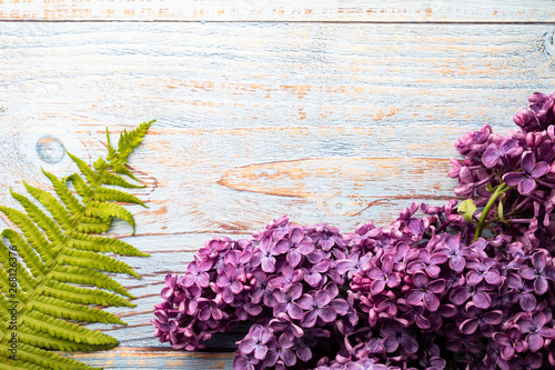 Flowers, violet lilac. Beautiful spring flower on a wooden background.