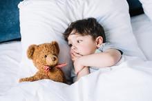 Cute Kid Lying On White Pillow...