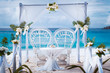 canvas print picture - Beach wedding arch gazebo ceremonial decorated with white flowers on a tropical grand anse sand beach. Outdoor beach wedding setup. La Digue, Seychelles