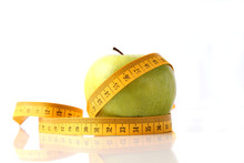 Apple And Measuring Tape Isolated On White.