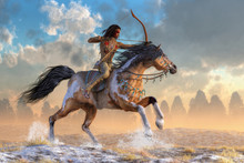 An American Indian Of The Western Plains Draws His Bow As His Horse Gallops Over Hills Kicking Up A Spray Of Snow. The Native American Man Wears Leggings, Moccasins, And War Paint. 3D Rendering
