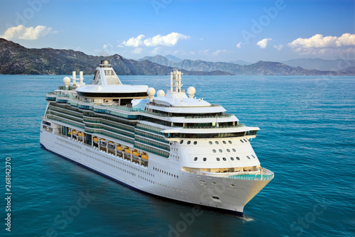 Luxury Cruise Ship Sailing from Port Fototapeta