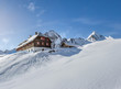 Wooden mountain hut in the alps in winter
