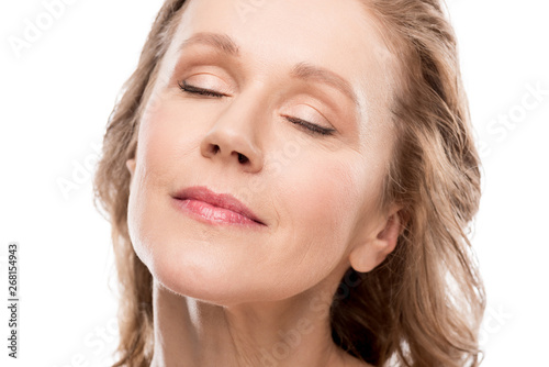 beautiful middle aged woman with clean face and eyes closed Isolated On White