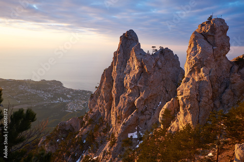 Fotobehang Grijze traf. Beautiful sunrise in the mountains. Top of Ai Petri mountain sunset view. Crimea, Russia