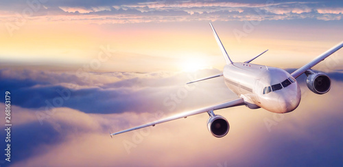 Door stickers Airplane Passengers commercial airplane flying above clouds