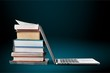 canvas print picture - Stack of books with laptop on table