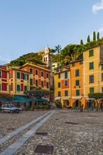 Colorful Houses Of The Piazzetta Square And Empty Outdoor Cafe In The Coastal Italian Village Portofino In Liguria Region, Italy