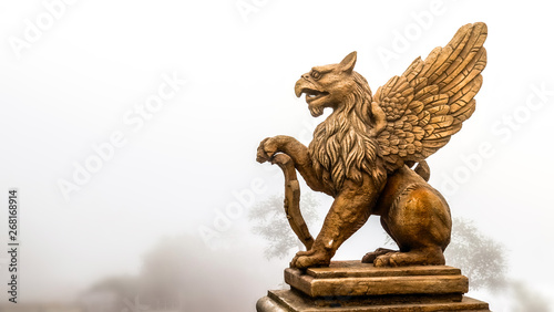 Foto  statue of Griffin or griffon a legendary creature with the body of a lion, the h
