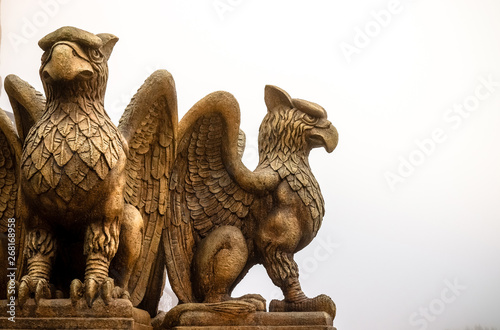 Fototapeta statue of Griffin or griffon a legendary creature with the body of a lion, the h