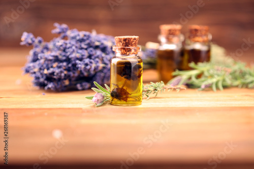 Keuken foto achterwand Lavendel essential lavender oil in a glass bottle on a background of fresh flowers