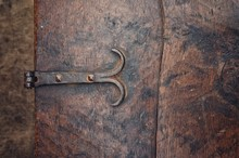 Texture From The Lid Of An Antique Wooden Chest, With Handmade Iron Hinges.